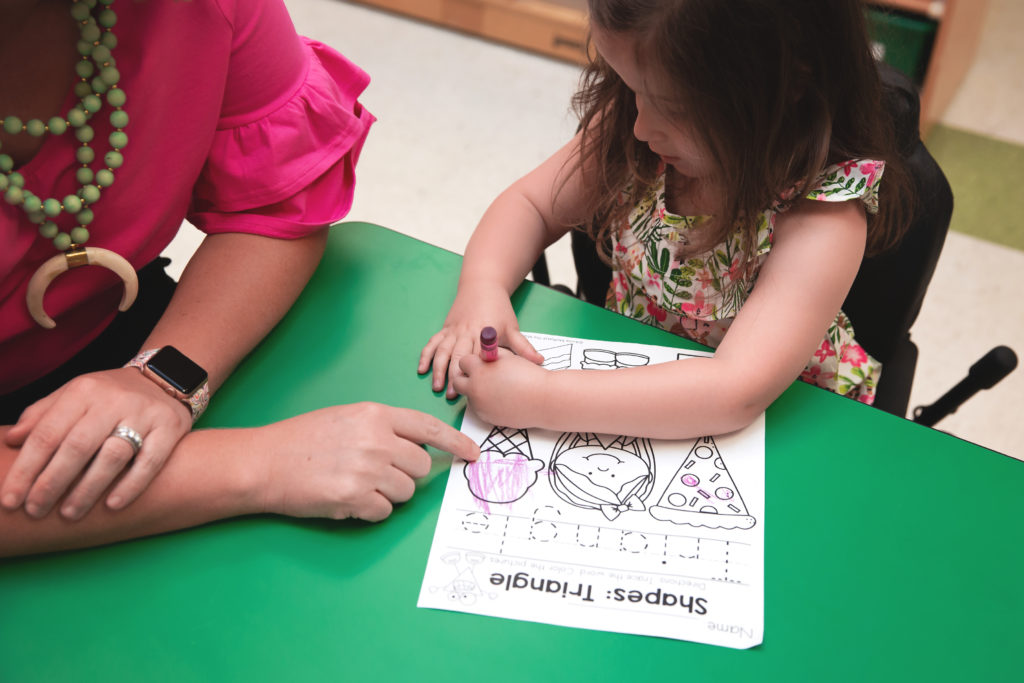 adult and child at table coloring