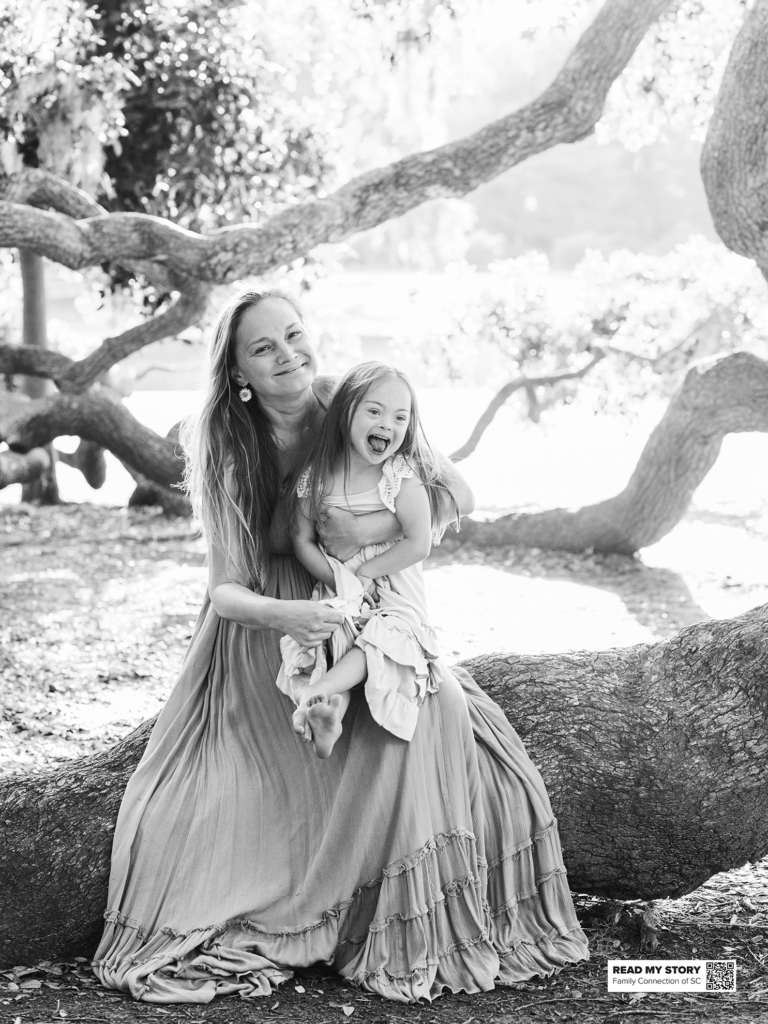 girl sits with her mother